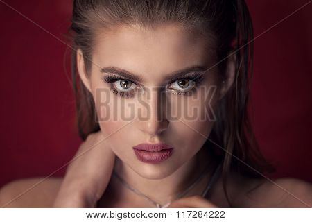 Beauty Portrait Of Young Woman With Glamour Makeup.