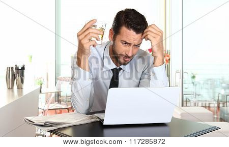 Worried And Tired Businessman In Crisis Working On Computer Laptop At Bar Table In Stress Under Pres