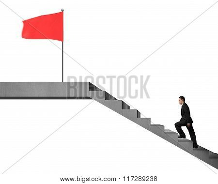 Businessman Climbing On Stairs To The Top For Red Flag