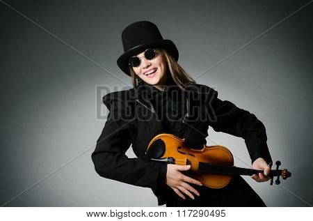Woman playing classical violin in music concept