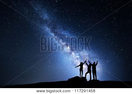Milky Way. Night Sky And Silhouette Of A Family