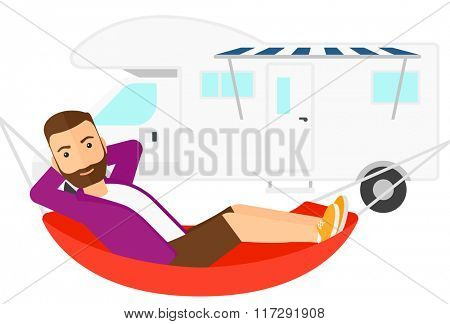 Man lying in hammock.