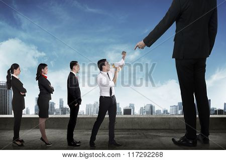 Business Team Protest To The Boss Using Megaphone