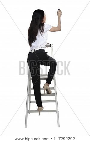 Asian Woman Write Something With Pen On The Ladder
