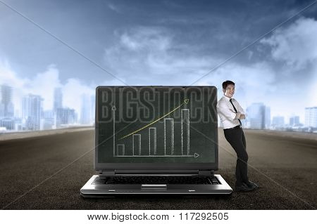 Business Man Show Report On Big Laptop