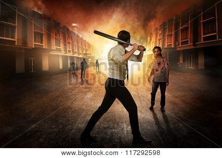 Man In White Shirt Holding Baseball Bat