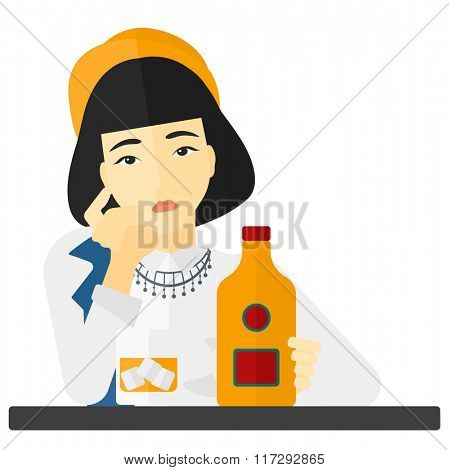 Sad woman with bottle and glass.