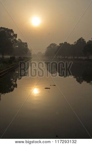Sun Scene On Pond