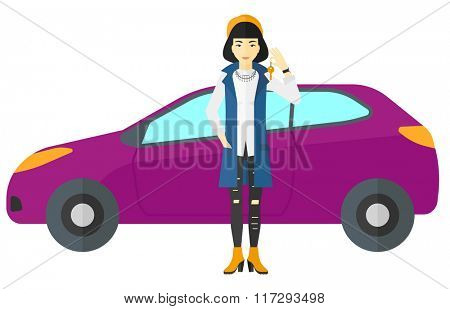 Woman holding key from new car.