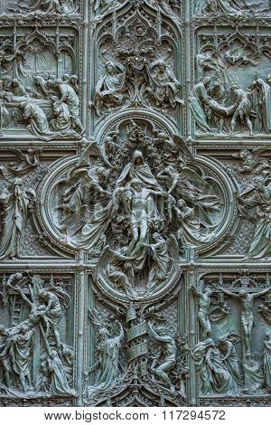Beautiful carved doors of Il Duomo or Milan Cathedral in Milan, Italy