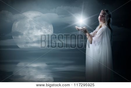 Elven girl with star on sea coast