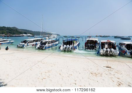 PHI PHI ISLANDS, THAILAND - CIRCA FEBRUARY, 2015: Speed boats on the shore of the island of Phi Phi Doh in the Andaman Sea. Island is very popular with tourists from all over the world
