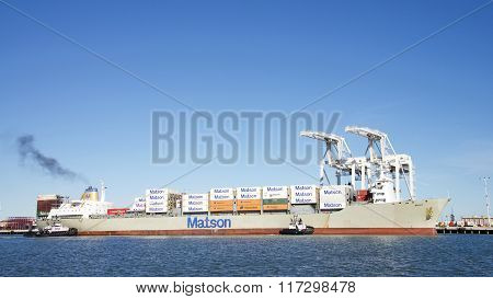 Matson Cargo Ship Maui Entering The Port Of Oakland With Tugboats Assisting