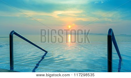 Swimming Pool And Stair With Sunset Background