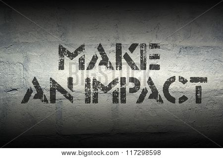 make an impact stencil print on the grunge white brick wall