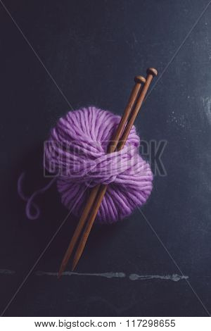 Skein of yarn with knitting needles