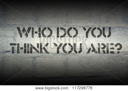 who do you think you are question stencil print on the grunge white brick wall