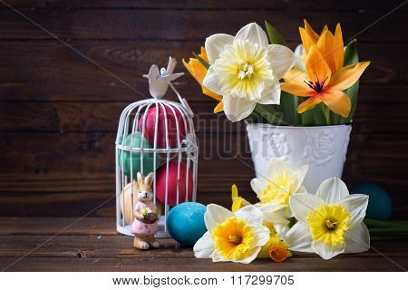 Colorful Easter Eggs In Bird Cage, Decorative Rabbit And  Flowers
