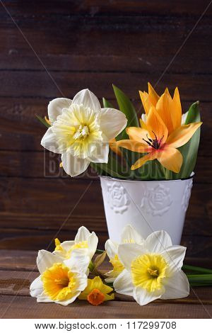 Spring Yellow Narcissus  Flowers  In Bucket On Brown Painted Wooden Planks.