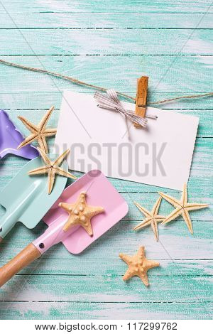 Tools For Playing In Sand  And Sea Object On Turquoise Wooden Planks.