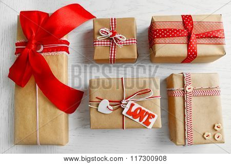 Set of wrapped gifts on light table