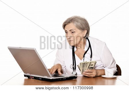 Senior female doctor with laptop