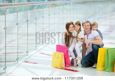 Young family with children in the store