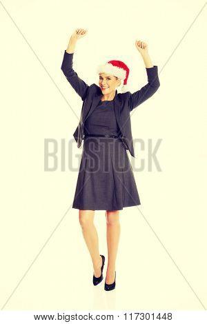 Happy businesswoman wearing christmas hat