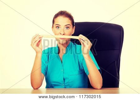 Young female dietician holding measure tape