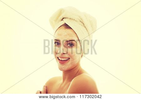 Smiling woman with face cream