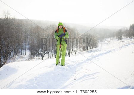 Girl In Winter Clothes With A Backpack.