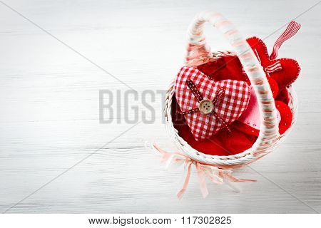 St Valentine's decor on light wooden background