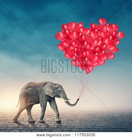 Elephant going with red balloons