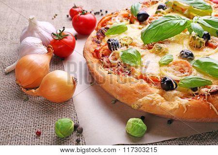 Delicious fresh pizza closeup