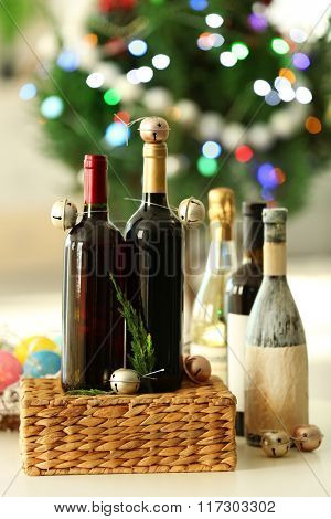 Wine in wicker box and Christmas decor in a room