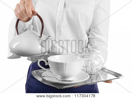 Waiter holding tray with teapot and cup on white background