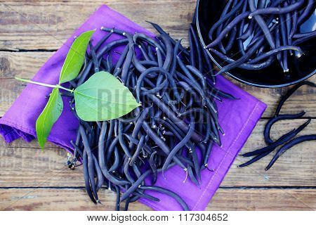 Blue beans on a wooden table