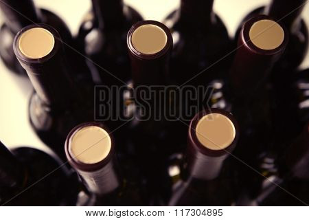 Stacks of wine bottles, close up