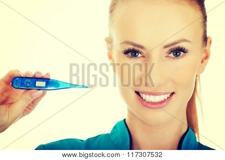 Attractive doctor with a thermometer.