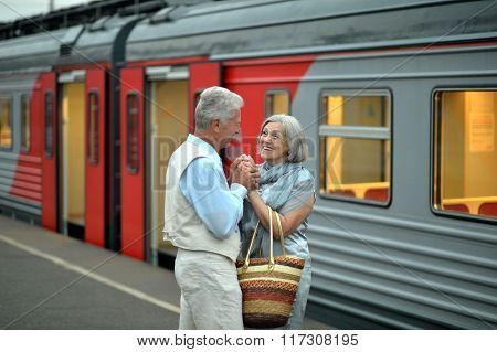 Mature   couple at the train station