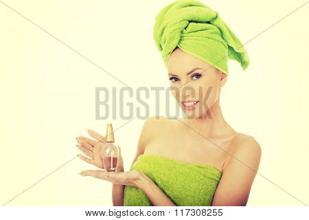 Beautiful woman with bottle of perfume.
