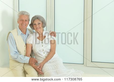 mature couple sitting near