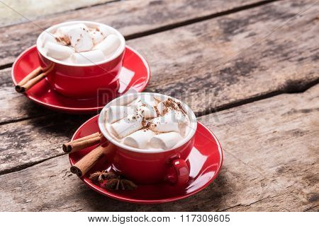 Hot Chocolate With Marshmallow On Wooden Table