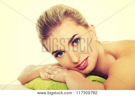 Smile young woman relaxing in spa