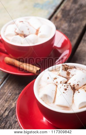 Two Red Cups Of Hot Chocolate Or Cocoa On The Table