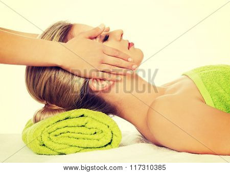 Young woman has face massage.