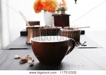 Coffee preparation on kitchen table, close up