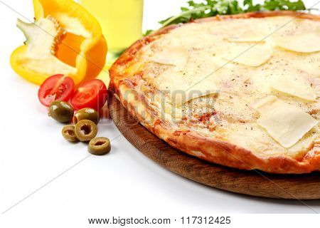 Full of cheese pizza on wooden board with vegetables, close up