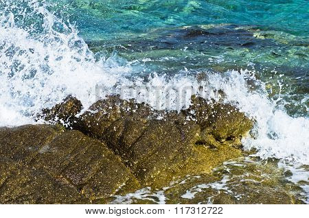 Sea rocks, waves and turquoise water at early morning, Sithonia, Greece
