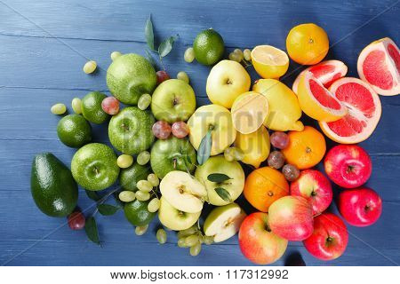 Fruits on dark blue wooden background